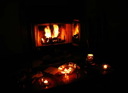 Use fire to help keep water warm until the temperature goes back up