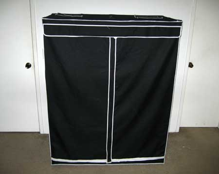 Example of a 2'x4'x5' grow tent - it's easy for your plants to get too tall in a setup like this!