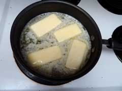 Add butter to the water on the stove top