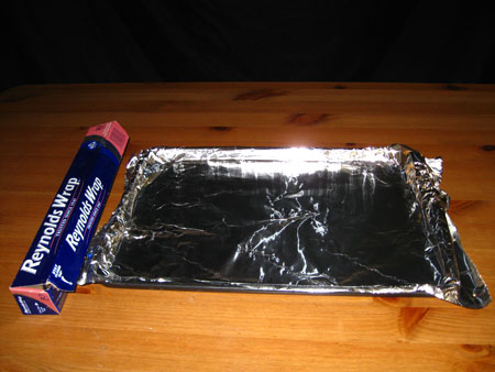 Line baking sheet with aluminum foil.