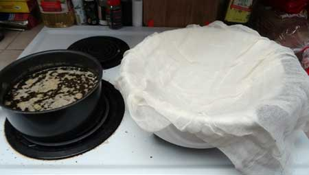 Line a bowl with two layers of cheese cloth, we'll be using this to strain out the plant matter from the butter