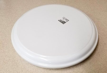 Cover the plate with another plate so the seeds and paper towels don't dry out