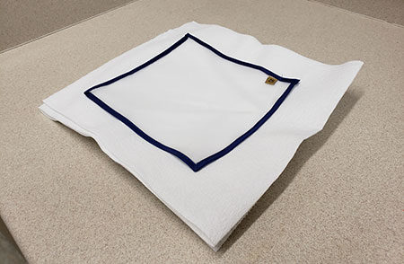 A 25-micron drying sheet on stacked paper towels