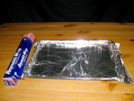 A baking sheet lined with aluminum foil