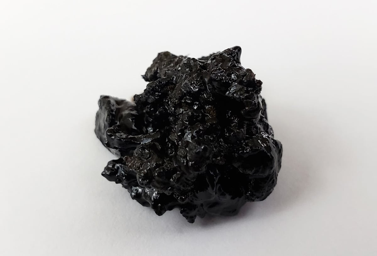 "A ball of black ""reclaim""; the gross kind of resin"