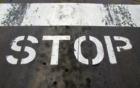 """Stop"" painted on a oily road"
