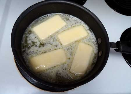 Add butter to the water on the stove top for this cannabutter recipe